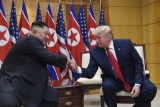 President Donald Trump meets with North Korean leader Kim Jong Un at the borde r village of Panmunjom in the Demilitarized Zone, South Korea, Sunday, June 30, 2019. (AP Photo/Susan Walsh)