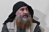 (FILES) In this file photo taken on April 30, 2019 In this undated tv grab taken from a video released by Al-Furqan media, the chief of the Islamic State group Abu Bakr al-Baghdadi purportedly appears for the first time in five years in a propaganda video in an undisclosed location. - Baghdadi was believed to be dead after a US military raid in Syria\'s Idlib region, US media reported early on October 27, 2019. (Photo by - / various sources / AFP) / THIS PICTURE WAS MADE AVAILABLE BY A THIRD PARTY. AFP CAN NOT INDEPENDENTLY VERIFY THE AUTHENTICITY, LOCATION, DATE AND CONTENT OF THIS IMAGE. THIS PHOTO IS DISTRIBUTED EXACTLY AS RECEIVED BY AFP. RESTRICTED TO EDITORIAL USE - MANDATORY CREDIT \