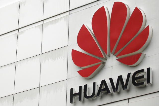 FILE PHOTO: The logo of the Huawei Technologies Co. Ltd. is seen outside its headquarters in Shenzhen, Guangdong province, April 17, 2012. . REUTERS/Tyrone Siu/File Photo