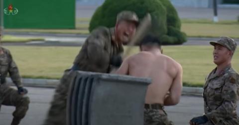 벌거벗은 군인들 손등 위로 쇠망치질…북한 자위 행사 목격한 외신