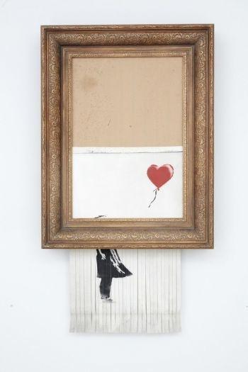 낙찰 순간, 절반 파쇄된 뱅크시 그림…3년만에 300억원 됐다